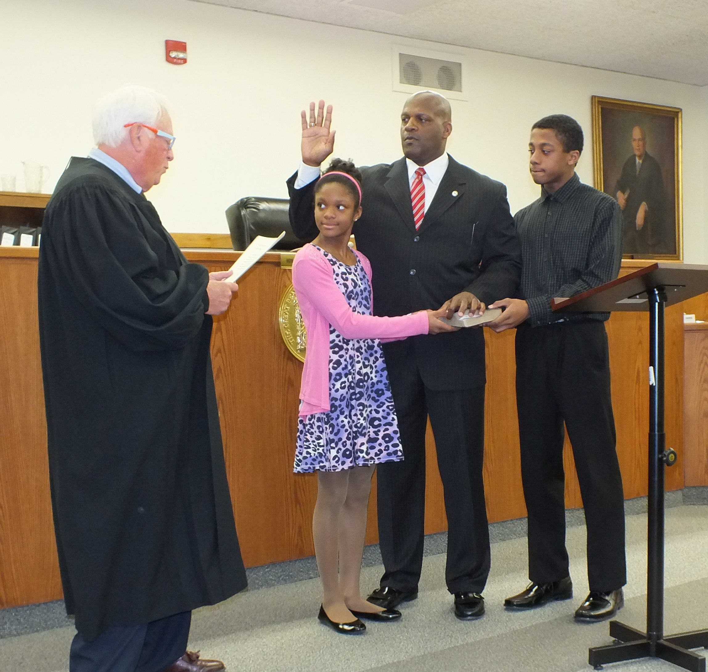 Ron Moten was sworn in as Chief of Detectives for the Camden County Prosecutor's Office on Wednesday, April 1, 2015.  Standing with Chief Moten are his daughter, Madison, 10, and his son, RJ, 12.  Retired Superior Court Judge Isaiah Steinberg, who mentored Chief Moten, is pictured on the left.